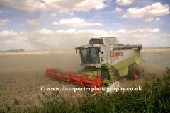 Combine harvester in Fenland fields, Spalding