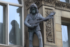 Statue of George Harrison on the Hard Day's Night Hotel, Liverpool, Merseyside, England, UK