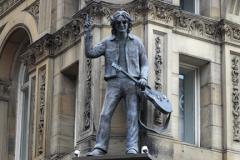 Statue of John Lennon on the Hard Day's Night Hotel, Liverpool, Merseyside, England, UK