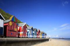 Colourful wooden beachuts on the promenade at Cromer town, North Norfolk Coast, England, UK