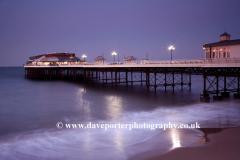 Dusk colours over the Pavilion Theatre pier at Cromer, North Norfolk Coast, England, UK