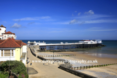 Summer day view over the promenade and Pavilion Theatre at Cromer town, North Norfolk Coast, England, UK
