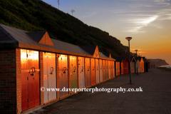 Summer, June, July, Sunset Beach Huts, Cromer town, North Norfolk Coast, England, UK