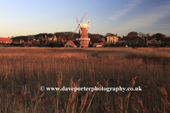 Sunset view over reed beds to Cley Windmill, Cley-next-the-Sea village, North Norfolk Coast, England, UK