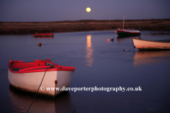 Boats by moonlight Blakeney Harbour North Norfolk