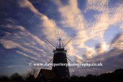 Sunset Dusk Colours over the Windmill at Burnham Overy Staithe village, North Norfolk Coast, England, UK
