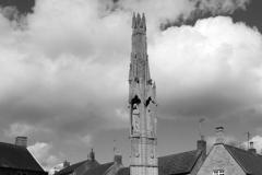 The Queen Eleanor Cross in the village of Geddington, Northamptonshire, England.