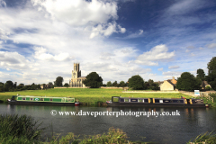 Narrowboats, St Mary and all Saints church, river Nene, Fotheringhay village, Northamptonshire, England, Britain