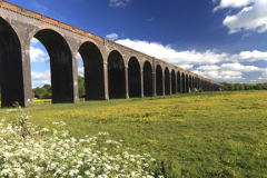 Summer view of the Harringworth Railway Viaduct, river Welland valley, Harringworth village, Northamptonshire, England; Britain; UK