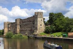Narrowboats passing Newark Castle, river Trent
