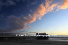 Sunset over the Victorian pier at Weston Super Mare town, Bristol Channel, Somerset County, England, UK