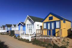 Beach huts on Mudeford Sandbank and Mudeford Quay at the entrance to Christchurch Harbour, Christchurch, Dorset, UK