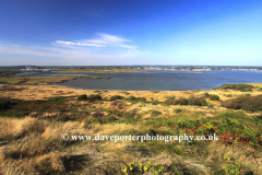 Summer view over Hengistbury Head and Christchurch Harbour, Christchurch town, Dorset County; England, Britain, UK