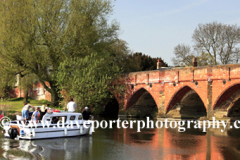 Boat and bridge over the river Great Ouse, Great Barford village, Bedfordshire, England, UK