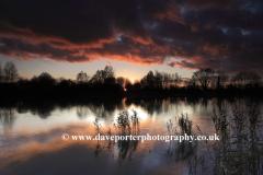 Winter sunset over a Fenland Drain, Cambridgeshire, England; Britain; UK