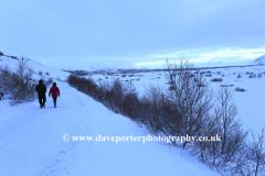 Tourists walking at Pingvellir National Park