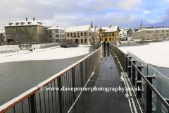 The frozen Tjornin lake and City Hall, Reykjavik