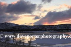 Sunrise over the frozen Kollafjordur lake