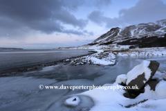 Sunrise over the frozen Kollafjordur fjord
