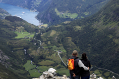 Tourists at the Dalsnibba mountain viewpoint, Geirangerfjord, UNESCO World Heritage Site, Sunnmøre region, Møre og Romsdal county, Western Norway, Scandinavia, Europe.