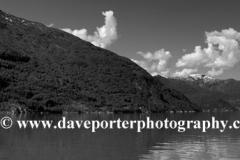 Reflections of the mountains surrounding Sognefjorden Fjord, Sogn Og Fjordane region of Norway, Scandinavia, Europe.