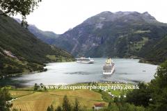 View of cruise ships in Geirangerfjord, Geiranger town, UNESCO World Heritage Site, Sunnmøre region, Møre og Romsdal county, Western Norway, Scandinavia, Europe.