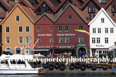People outside the Hanseatic buildings forming part of the Bryggen, a UNESCO World Heritage Site, Bergen City, Hordaland, Norway, Scandinavia Europe,