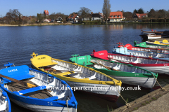 Colourful wooden rowing boats for hire on the Mere at Thorpeness village, Suffolk County, England
