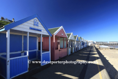 Colourful wooden Beach huts on the promenade, Southwold town, Suffolk County, England, United Kingdom