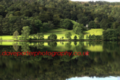 Reflections in Grasmere Water, Lake District National Park, Cumbria County, England, UK.