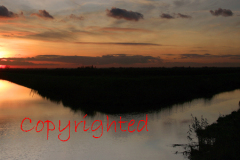 Sunset over a Fenland drain waterway near March
