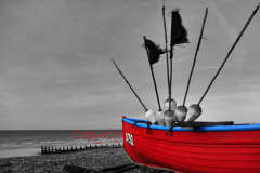 Red fishing boat on the beach, Worthing