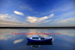 Dusk colours over a Fishing Boat in Blakeney village
