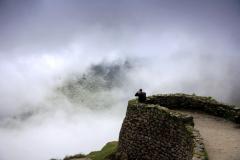 Tourist at Phuyupatamarca complex, Inca Trail, Peru